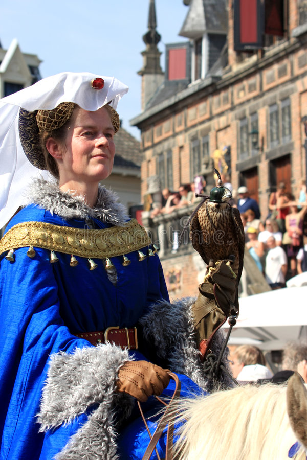 Medieval dressed lady with falcon royalty free stock images