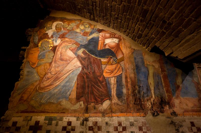 Fresco, Judas Kiss,  betrayal, Crypt, Cathedral, Siena, Tuscany, Italy. Medieval and early renaissance fresco with the betrayal of Jesus Christ by Judas Iscariot royalty free stock image
