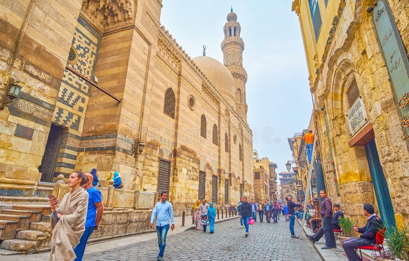 The medieval edifices of old Cairo, Egypt. CAIRO, EGYPT - DECEMBER 20, 2017: The Al-Muizz street is the most notable place in old town with numerous historical stock photos