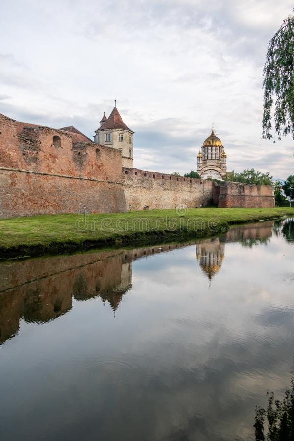 Medieval Fagaras fortress and the orthodox Cathedral of St. John the Baptist, Brasov, Romania royalty free stock photo