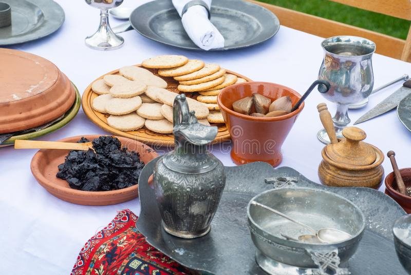 Medieval food table with biscuits fruits and pickle stock photo