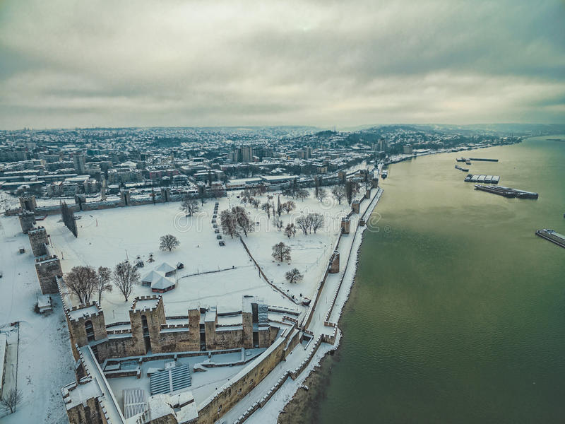 Medieval fortress covered in snow stock photography