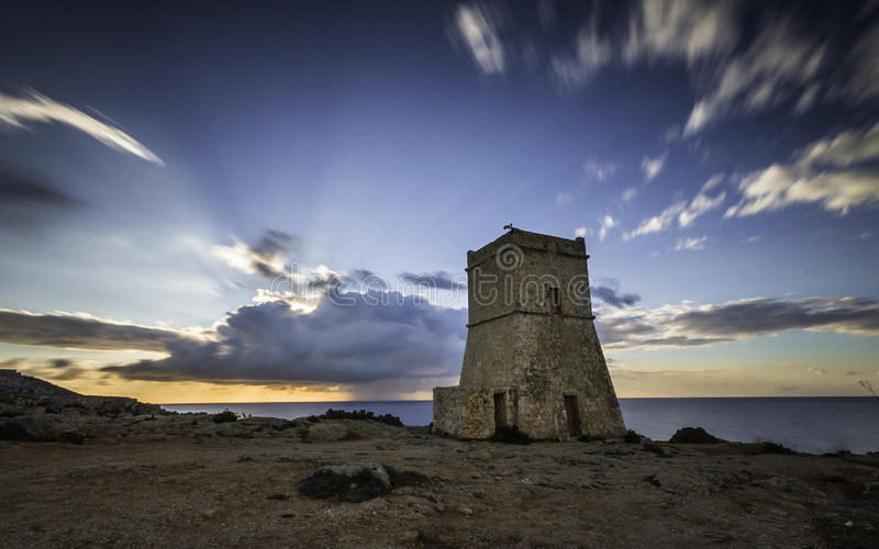 Medieval fortress on the hill at golden bay at Sunset, Malta, Europe royalty free stock photos