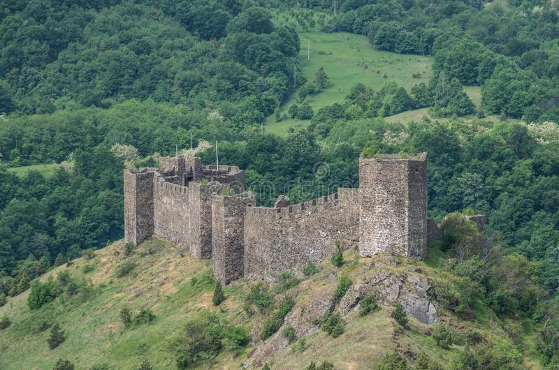 Medieval fortress Maglic on mountain cliff stock photo