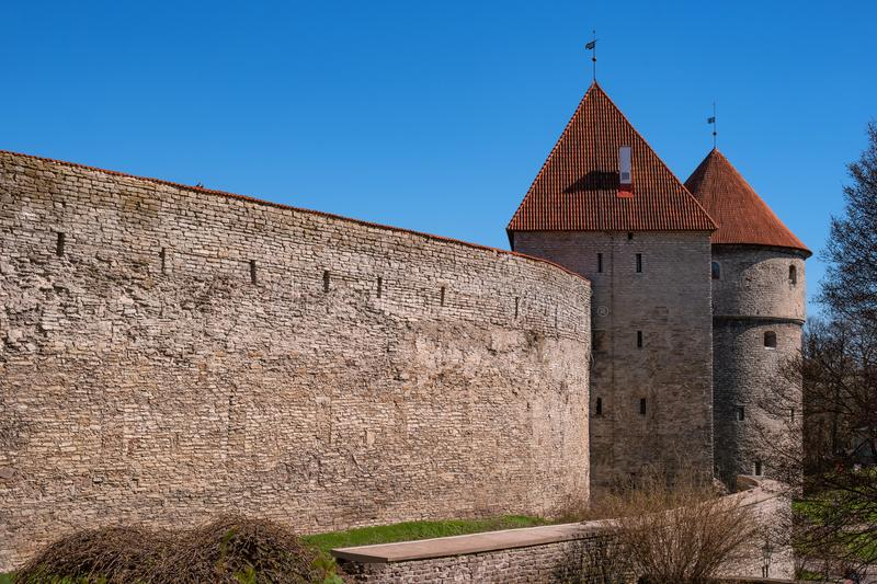 Medieval fortress with towers in the Old town. Tallinn, Estonia. The towers have a red tiled roof royalty free stock photo