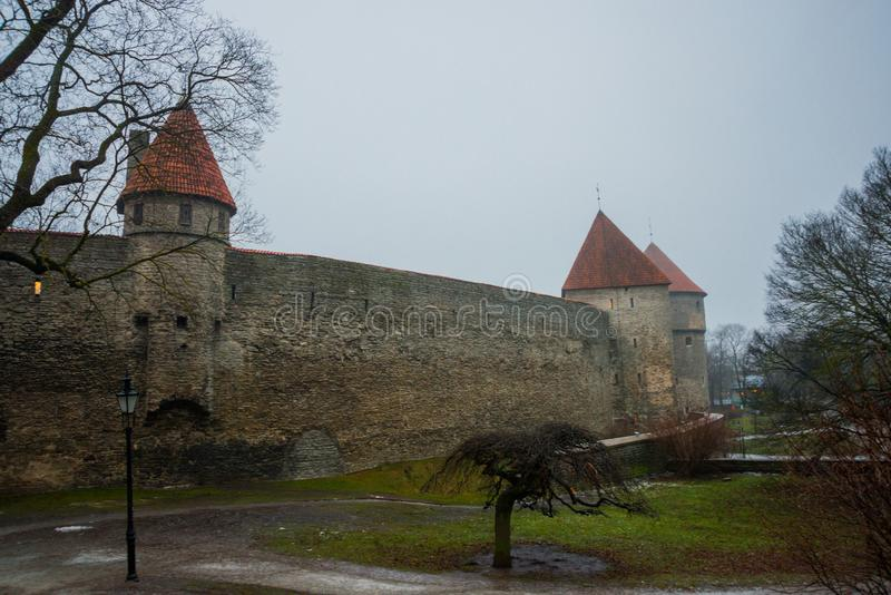 Medieval fortress with towers in the Old town. Tallinn, Estonia. The towers have a red tiled roof stock photography
