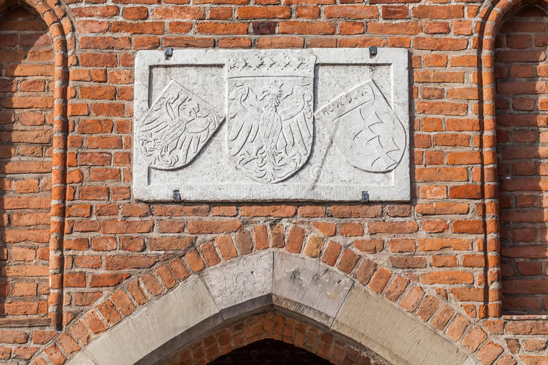 Medieval gate - Old Town, Gdansk - Poland. Medieval gate of the coat of arms of the city of Gdansk and the emblem of the Polish royalty free stock photography