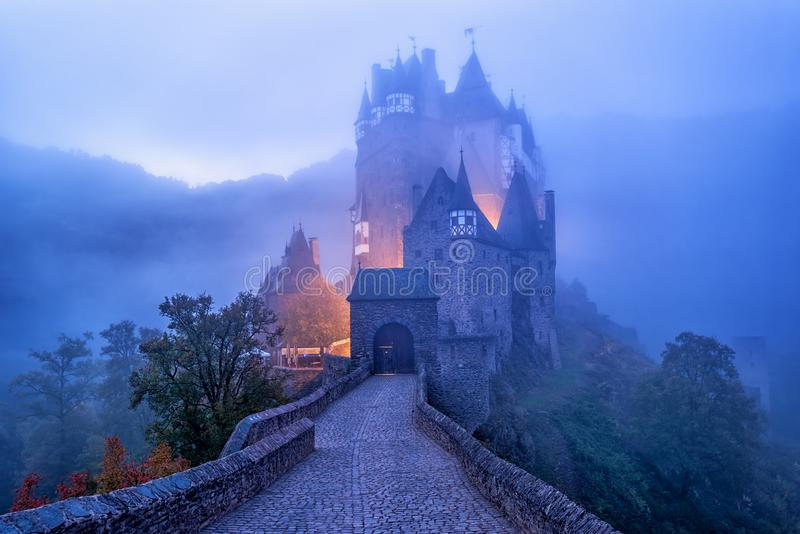 The medieval gothic Burg Eltz castle in the morning mist, Germany royalty free stock photo