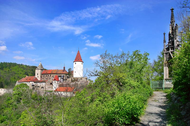 Medieval gothic royal castle with ramparts Krivoklat near Rakovnik, Central Bohemia region, Czech republic. National cultural lan. Dmark royalty free stock image