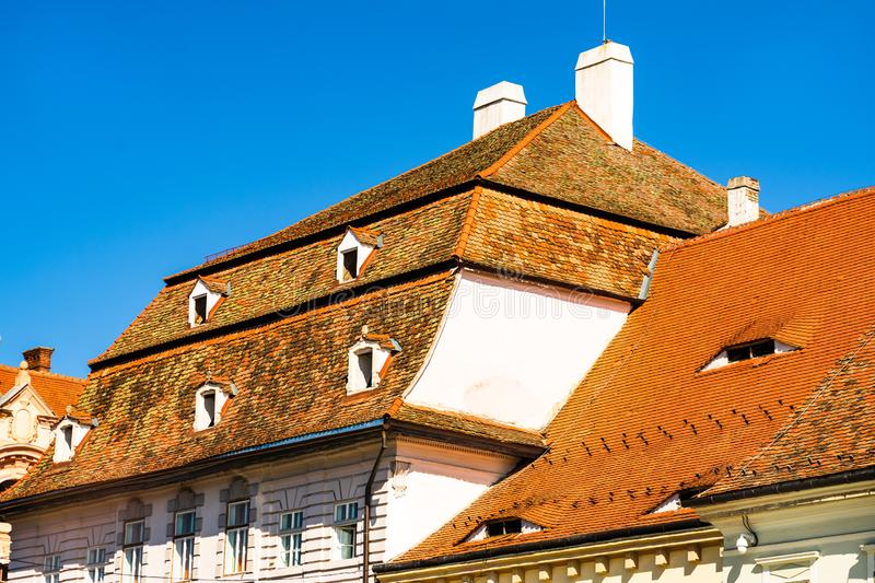 Medieval house in Sibiu with old roof tiles and old paint.  royalty free stock photos