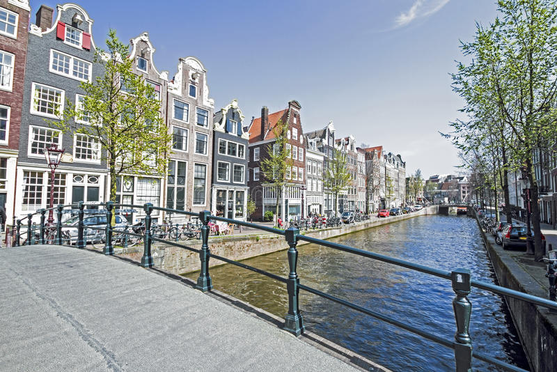 Medieval houses along the canal in Amsterdam Netherlands stock images