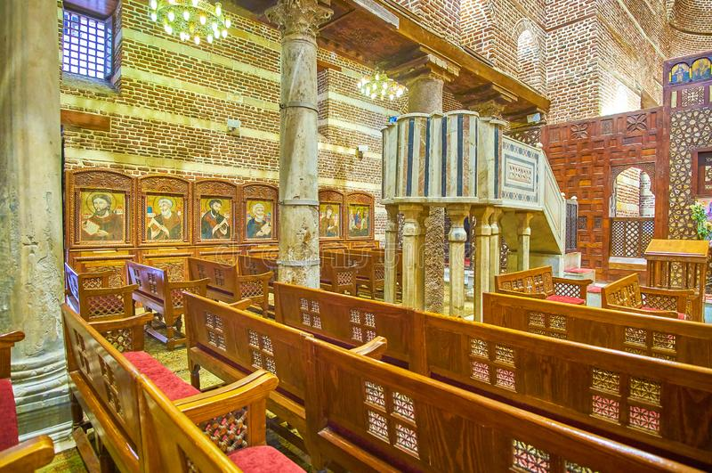 The medieval interior od St Barbara Church in Cairo, Egypt. CAIRO, EGYPT - DECEMBER 23, 2017: The medieval St Barbara Church boasts Byzantine style ancient icons stock photos