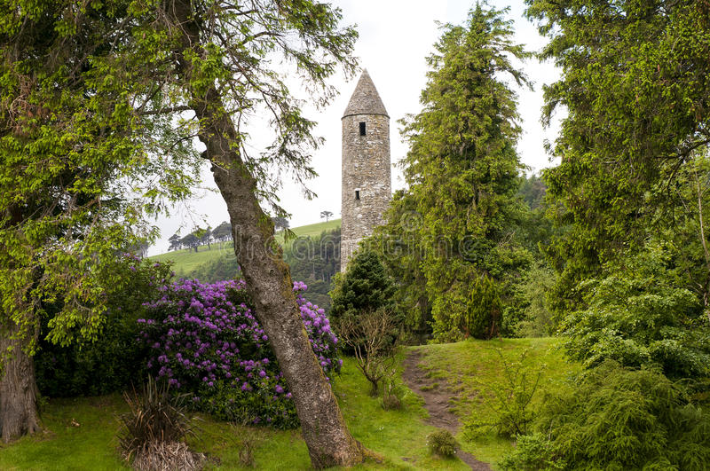 Medieval Irish tower ruins. Scenic Medieval ruins of a stone tower at Glendalough, County Wicklow, Ireland royalty free stock photography