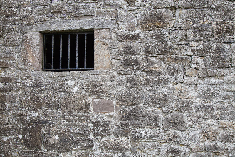 Medieval jail wall with a window. royalty free stock images