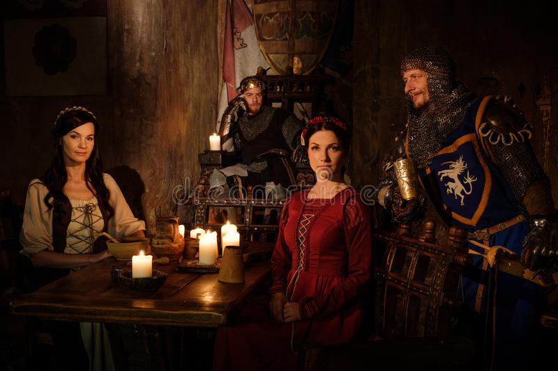 Medieval king and his subjects communicate in the hall of the castle stock images