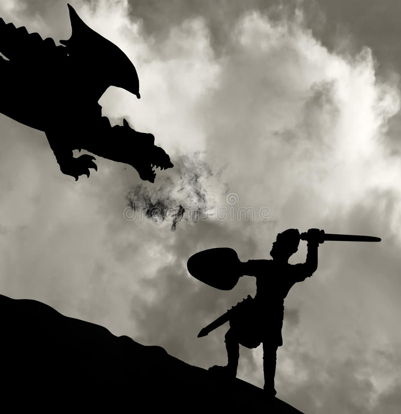 Medieval knight fighting the dragon royalty free stock images