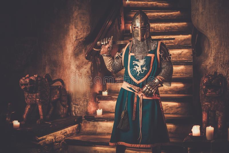 Medieval knight on guard in ancient castle interior. royalty free stock photo