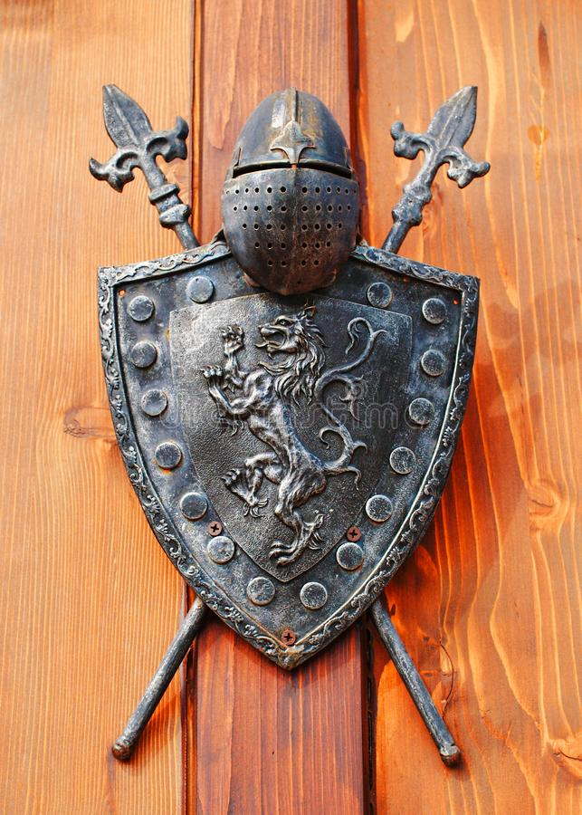 Medieval knight helmet and shield stock photo