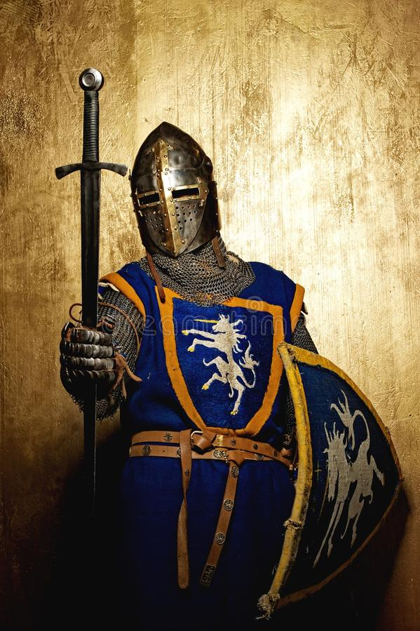 Medieval knight holding sword in his hand stock images