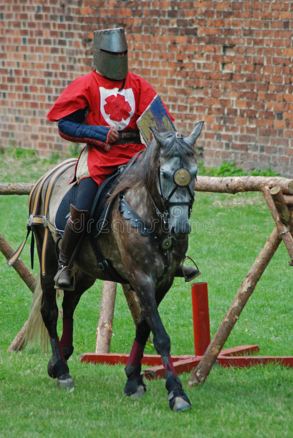 Medieval knight on a horse stock images