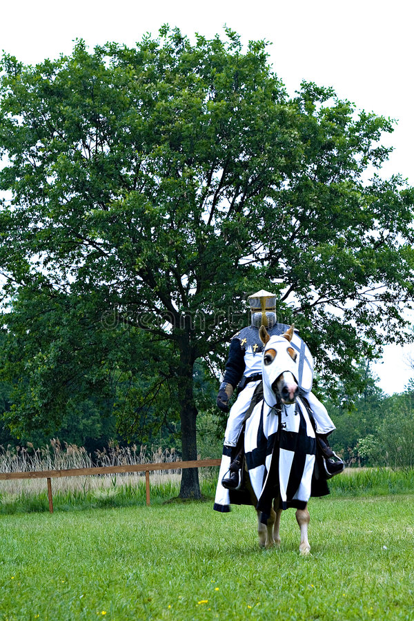 Medieval knight on horse royalty free stock photography