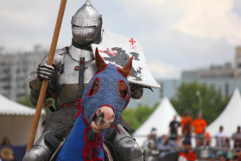 Medieval knight on horse in heavy protection stock images