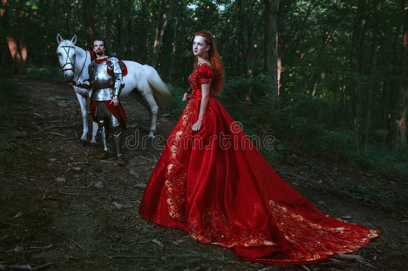 Medieval knight with lady royalty free stock photo