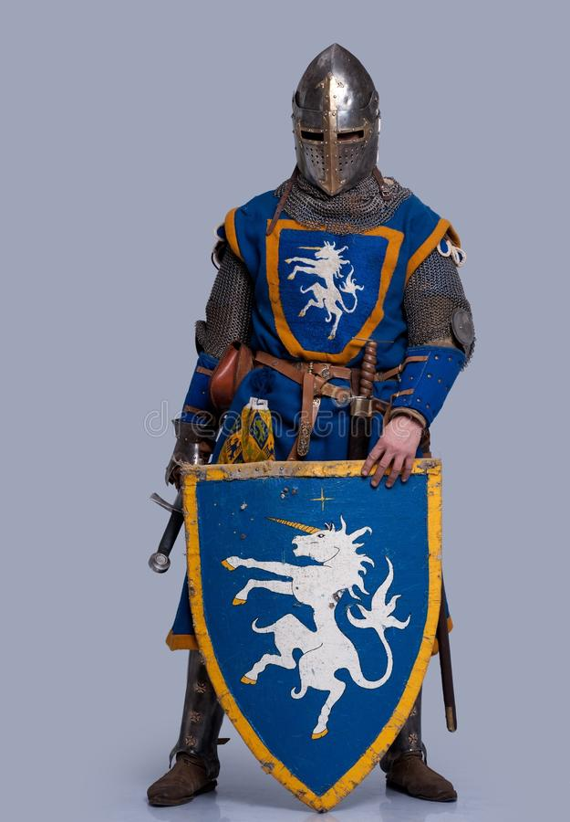 Medieval knight with shield in front of him royalty free stock images