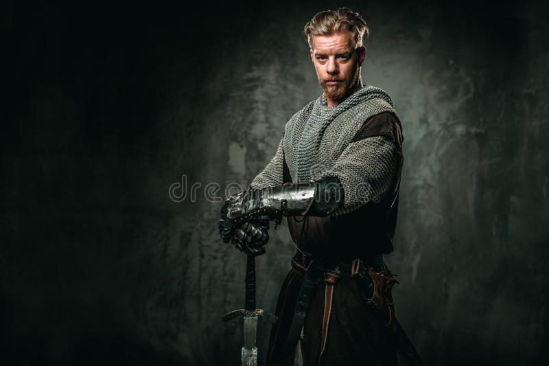 Medieval knight with sword and armour royalty free stock photo