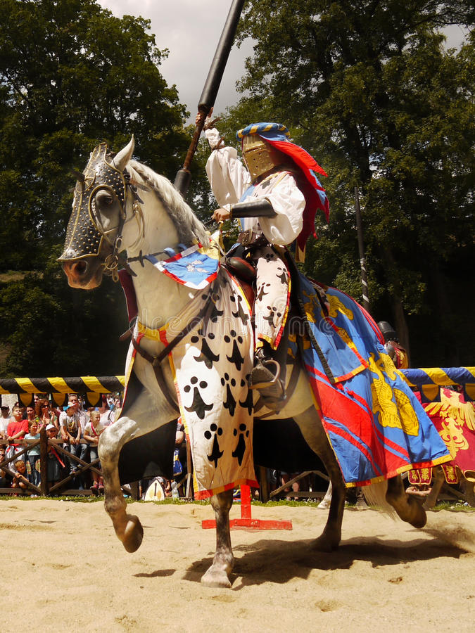 Medieval Knights Horse Riding Jousting, Prague Castle. Medieval knights jousting during a tournament. The Days of The Knights - Prague Castle. Czech republic royalty free stock photos