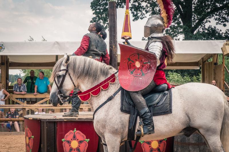 Medieval Knights at Warwick Castle. A reenactment of the war of the Roses at the medieval Warwick Castle, Warwickshire, England, Europe royalty free stock photos