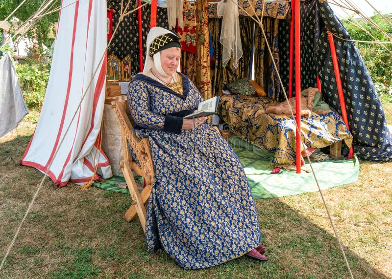 Medieval Lady, Tewkesbury Medieval Festival, England. A participant at the Tewkesbury Medieval Festival in Gloucestershire, England dressed in period costume of royalty free stock photo