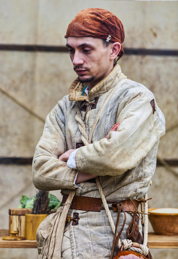 Medieval Man Preparing Food stock photos