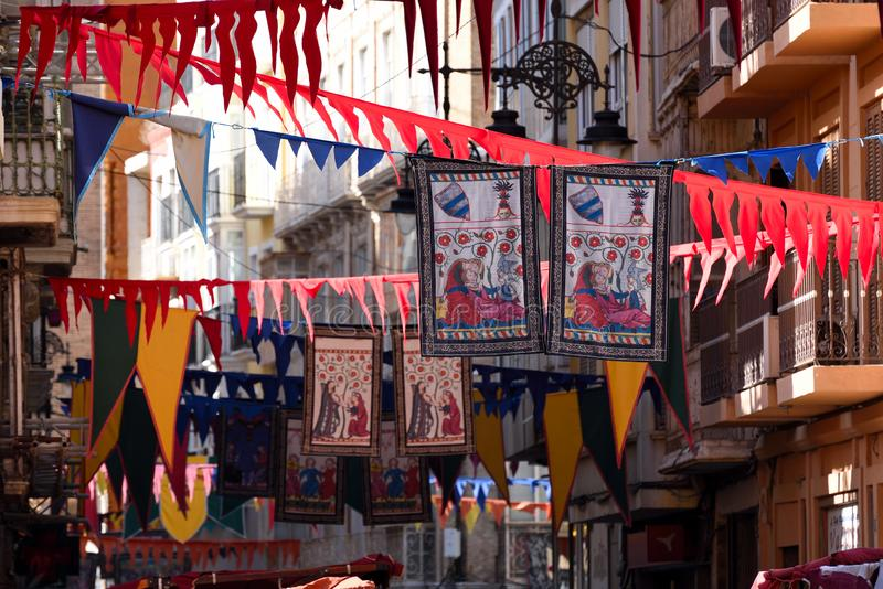 Medieval Market in Cartagena. Street of Cartagena decorated with flags. Historical festival of three cultures - Arabic, Jewish and Christian - Medieval Market in stock photo