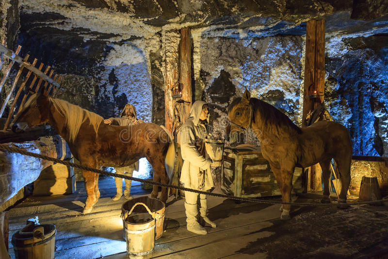 Medieval miner and horses at work in Wieliczka. Wieliczka Salt Mine operated continuously since the 13th century. Underground Mine has over 300 corridors and 300 stock photography