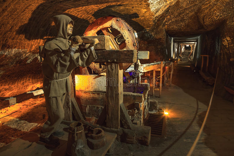 Medieval miner at work in the Wieliczka, Poland. Wieliczka Salt Mine operated continuously since the 13th century. Underground Mine has over 300 corridors and stock photography