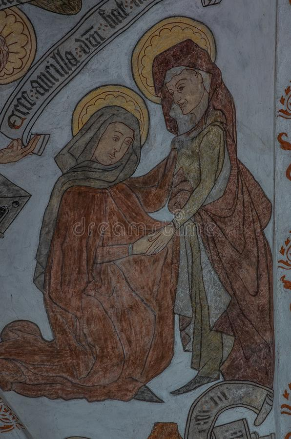 Medieval mural of the visitation, Virgin Mary pays a visit to Elisabeth, who also is pregnant. The visitation, Virgin Mary pays a visit to Elisabeth, a wall stock images