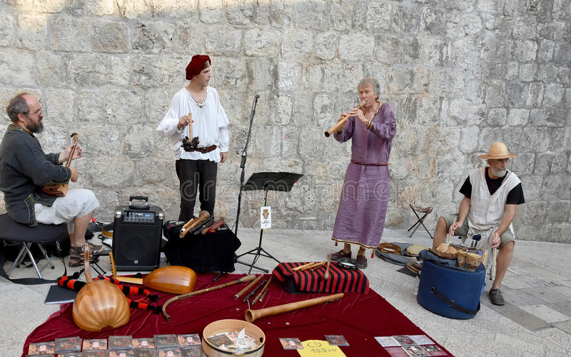 Medieval music in croatia. Group of musicians making medieval music with old instruments at the city wall in dubrovnik, croatia