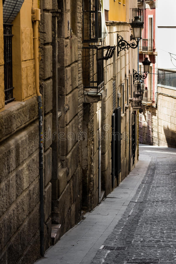 Medieval narrow streets of Alicante old town historic district Santa Cruz stock image
