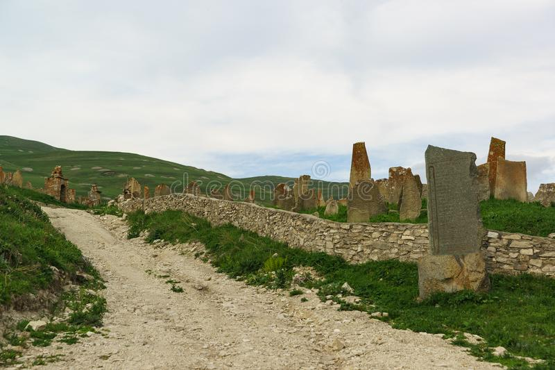 Medieval necropolis  City of the dead  in the settlement of Hoi. Tombstones are narrow, tall stones. Cloudy stock images