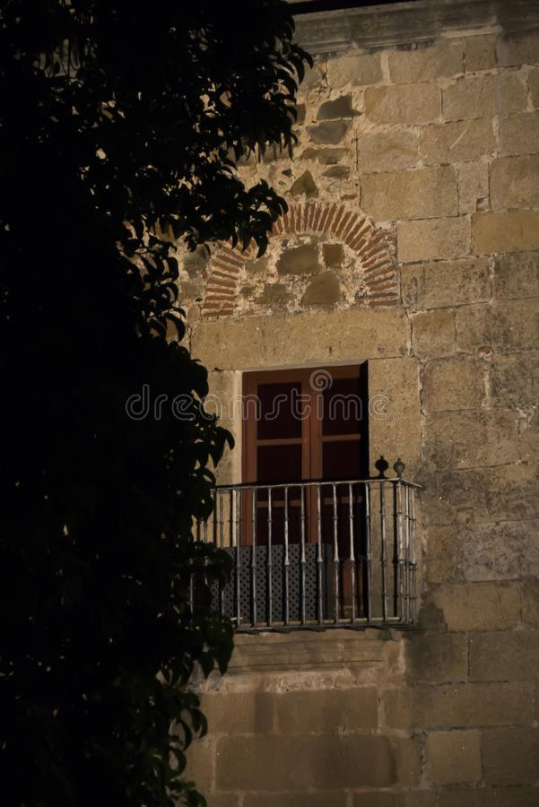 Window detail of medieval palace in the historic center of Caceres royalty free stock photography