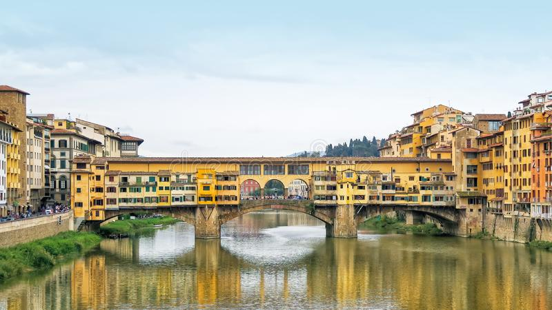 The medieval Ponte Vecchio crosses over the Arno River in Florence, Italy. royalty free stock images
