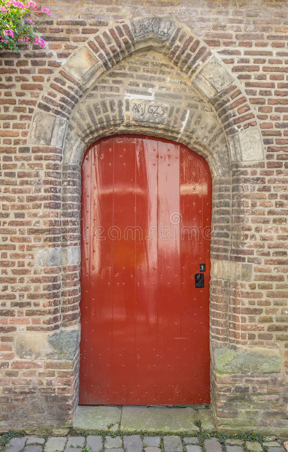 Medieval red door in the historical center of Zwolle stock photo