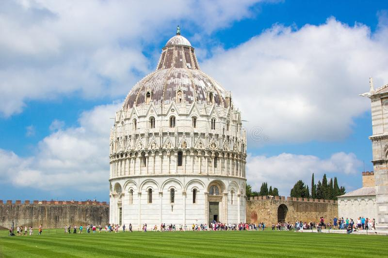 Pisa, Italy - May 24, 2018: Medieval Romanesque Pisa Baptistery of St. John Battistero di San Giovanni at Piazza dei Miracoli. Medieval Romanesque Pisa royalty free stock images