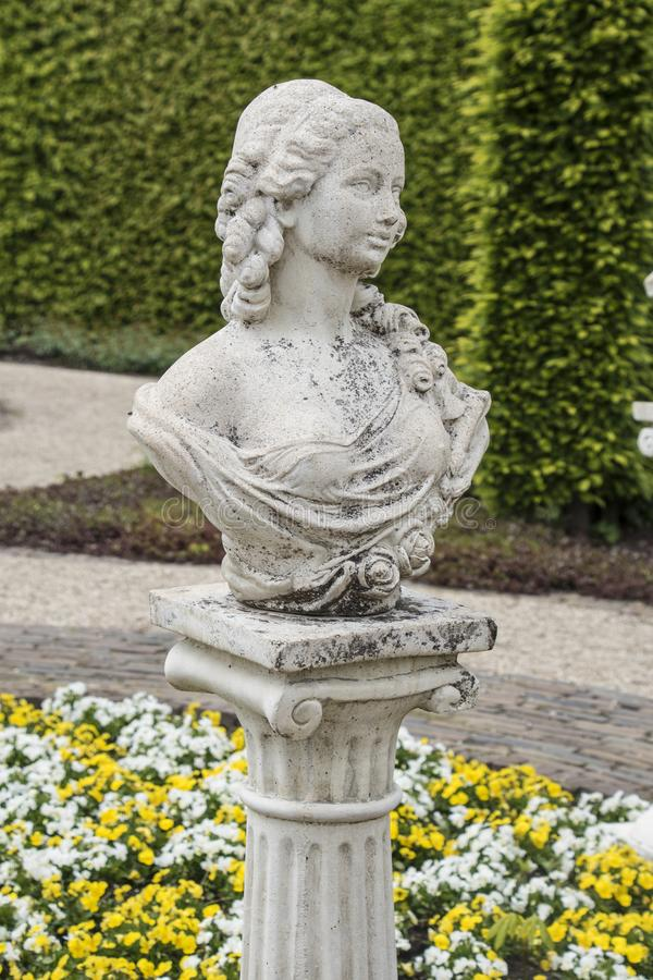 Medieval sensual woman sculpture in the gardens of Castle of Arcen, Netherlands.  royalty free stock image