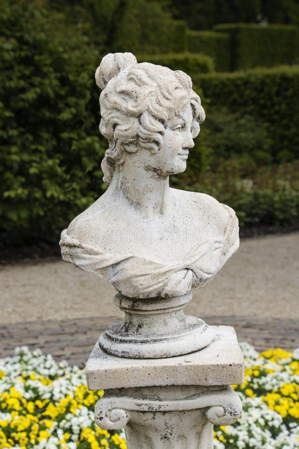 Medieval sensual woman sculpture in the gardens of Castle of Arcen, Netherlands.  royalty free stock images
