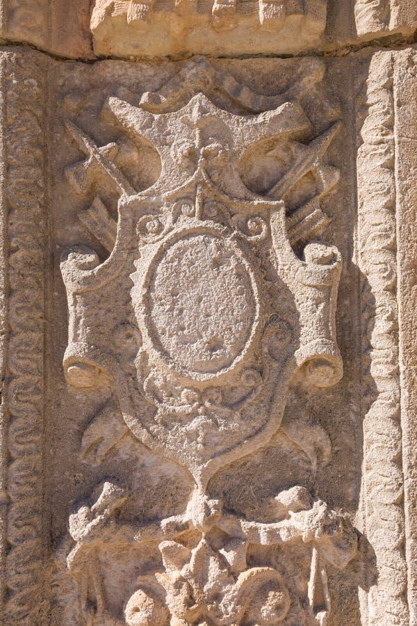 medieval shield relief in exterior building of Penaranda de Duero stock image