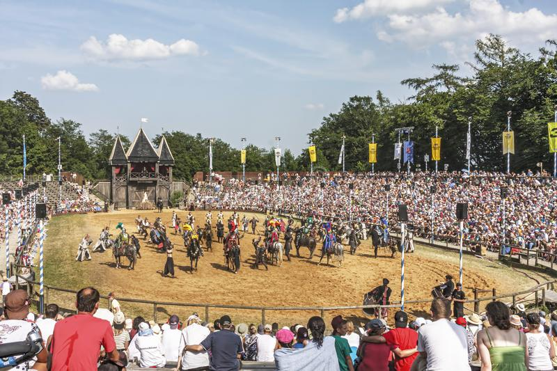 Medieval show in the Kalinger arena. Crowded arena saluting the medieval troupe at the medieval festival at Kaltinger, Germany stock photography