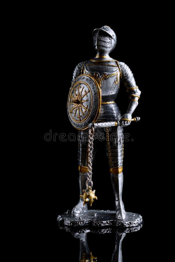 Medieval soldier dressed in armour with shield and weapon in hand, model, led, handpainted royalty free stock images