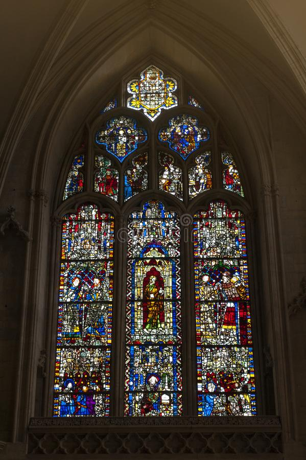 Medieval stained glass on east window of All Saints chapel inside cathedral of York Minster in City of York, England, UK. York, England - April 2018: Medieval royalty free stock photos